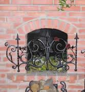 Кованая каминная декоративная решетка.