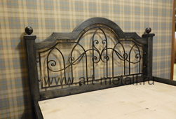 Wrought iron, oak bed.