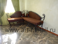 Wrought iron corner sofa.