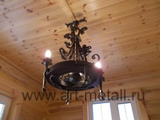 Forged chandelier with wood