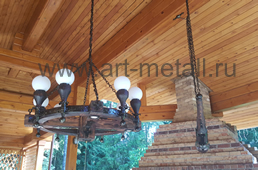 Wood chandelier with forged metall.