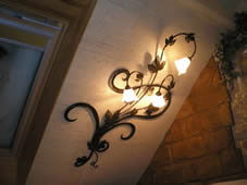 Wrought iron floral wall chandelier