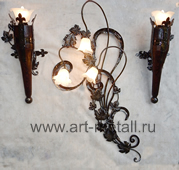 Wrought iron wall lamp floral style.