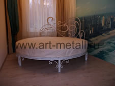 Wrought iron round bed.