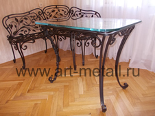 Wrought iron table. Floral style.