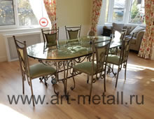 Wrought iron table, chairs. Oak, glass.