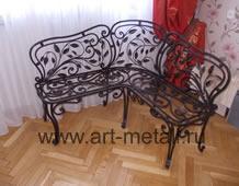 Iron corner sofa. Floral style.