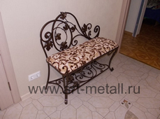 Iron chair with shoes shelf.