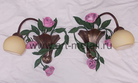 Wall sconce with forged roses.
