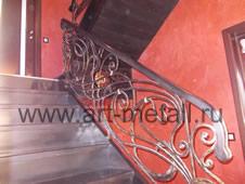 Stairs. Wrought iron railings.