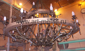 Large wrought iron chandelier with wood.