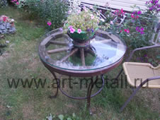 Wrought iron table from a cart wheel.