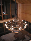 Wrought iron chandelier, wagon wheel style.