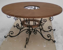 Forged table in the same style with the chandelier.