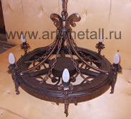 Chandelier made from wagon wheel.