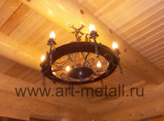 Forged chandeliers, wagon wheel style .