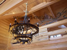 Forged chandeliers, wagon wheel style.