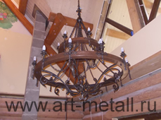The big forged chandelier with wood.