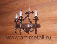Wrought iron sconce in the same style with the chandelier.