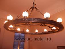 Wrought iron chandelier, stylized wagon wheel